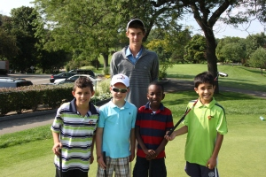 Clinic on putting green with TGA kids (12)